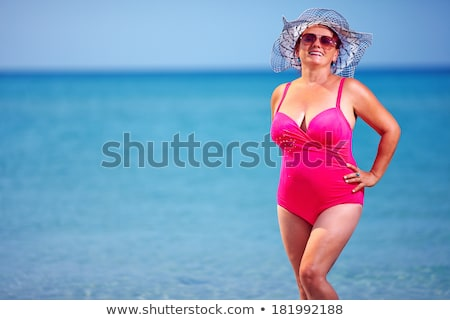 старший · женщину · купальник · пляж · девушки · улыбка - Сток-фото © is2