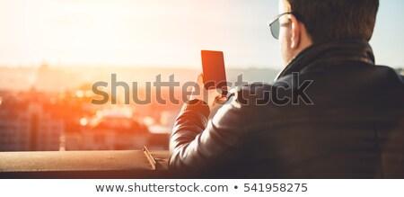 Városi férfi telefon visel napszemüveg kint Stock fotó © 2Design