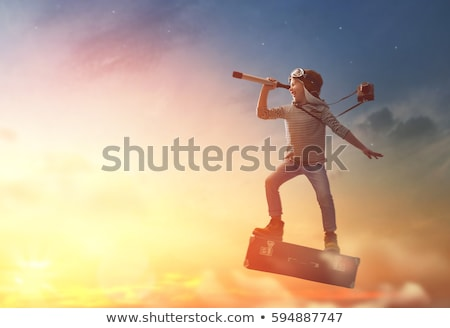 a happy boy with telescope stock photo © bluering