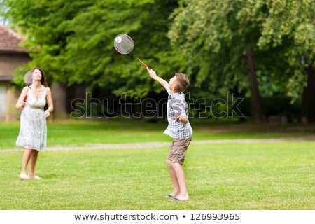 Family playing badminton on a meadow in summer Stock photo © Kzenon