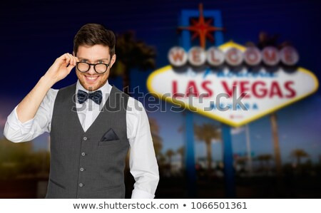 happy man in suit and eyeglasses at las vegas Stock photo © dolgachov
