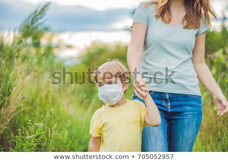 Mother and son in a medical mask because of an allergy to ragweed Stock photo © galitskaya