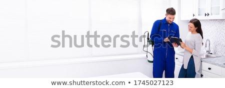 Bogárirtás munkás mutat számla nő fiatal Stock fotó © AndreyPopov
