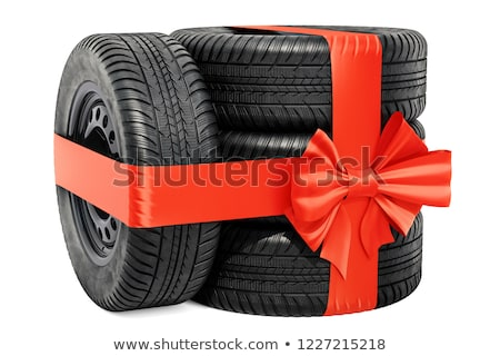 tire with red bow on white background isolated 3d illustration stock photo © iserg