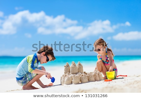 little girl making sand castle on beach stock photo © andreypopov