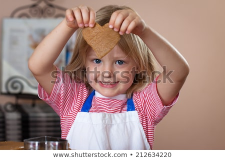 Young man preparing dough for homemade bread in the kitchen Stock photo © boggy