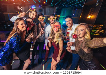 happy women with party props at night Stock photo © dolgachov