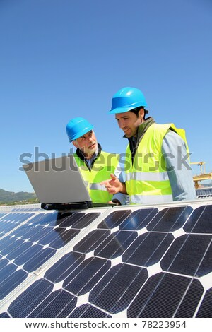 Manager and worker in photovoltaic power plant Stock photo © Kzenon