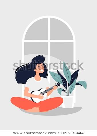 美しい · 若い女性 · 座って · ソファ · 演奏 · ギター - ストックフォト © artfotodima