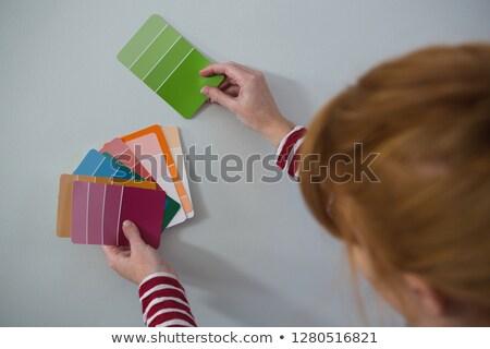 Feminino pintor correspondente cor casa estilo de vida Foto stock © wavebreak_media