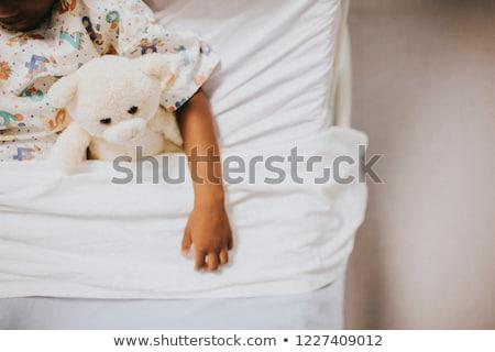 Little girl cama de hospital ursinho de pelúcia médico criança casa Foto stock © Lopolo