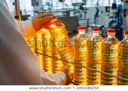Hand fles zonnebloemolie blauwe hemel business Stockfoto © nomadsoul1
