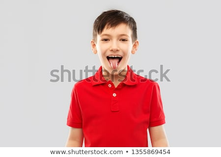 boy in red polo t-shirt showing his tongue Stock photo © dolgachov