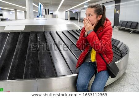 Zaklatott nő elveszett poggyász utazó lány Stock fotó © AndreyPopov