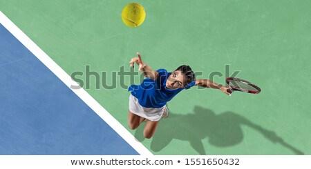 Woman hitting the tennis ball on the court Stock photo © Kzenon