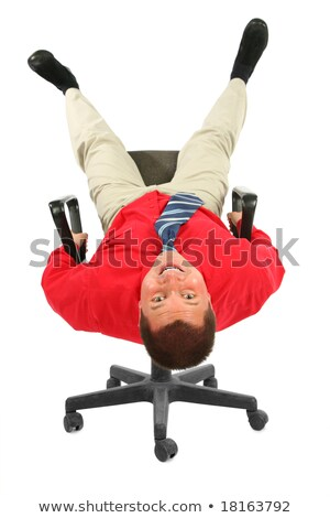 Businessman in  red shirt on  chair rests upside down Stock photo © Paha_L