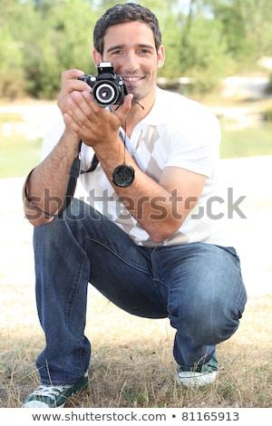 Fotograaf hurken platteland gras man portret Stockfoto © photography33