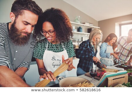 Couple cooking together with a recipe book Stock photo © photography33