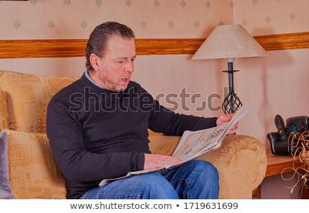 man sat reading on sofa stock photo © photography33