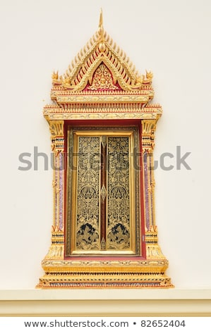 buddhist art on the wall in thai temple stock photo © rufous