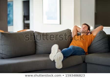 Adam rahatlatıcı oda ev gülen erkek Stok fotoğraf © photography33