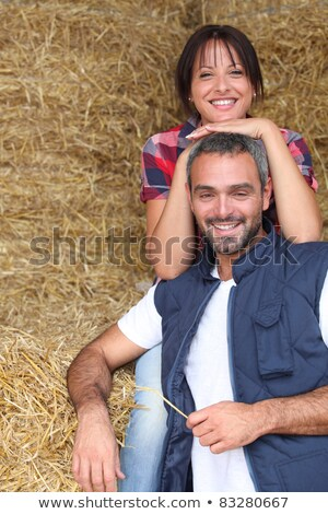 Farming couple sitting on a haystack Stock photo © photography33