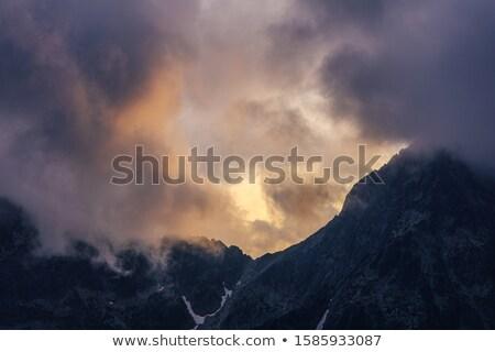 Dramatic sunset with beautiful clouds  Stock photo © artush