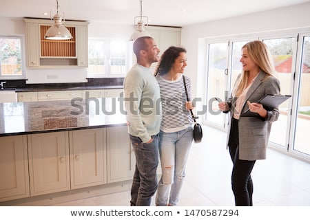 Woman at a house viewing Stock photo © photography33
