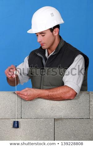 Mason checking wall is straight Stock photo © photography33