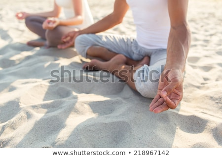 meditation yoga bodycare young woman on the beach stock photo © victoria_andreas