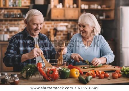 nő · vág · zöldség · vágódeszka · fiatal · nő · főzés - stock fotó © rob_stark