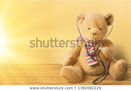 Nurse holding teddy bear Stock photo © photography33