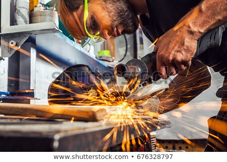 Young man using angle-grinder Stock photo © photography33