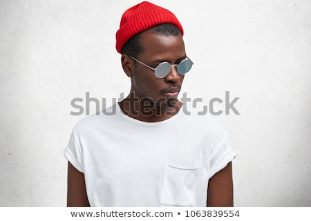 Young Black Man with Red Wall. stock photo © Schmedia