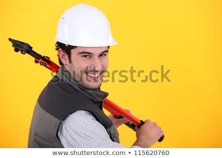 Man resting bolt cutters over shoulder Stock photo © photography33