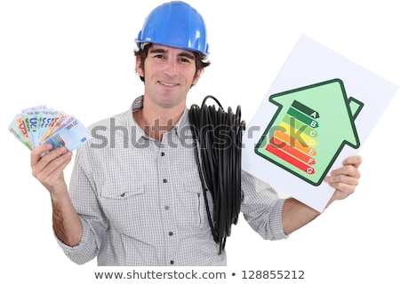 heating engineer holding bank notes rejoycing over purchase power Stock photo © photography33