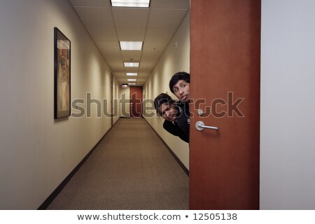 Woman sneaking out of the office Stock photo © photography33