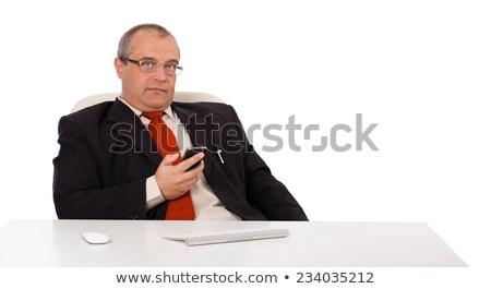 üzletember ül asztal tart iram izolált Stock fotó © ra2studio