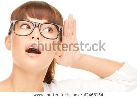 serious woman listening gossip stock photo © dolgachov