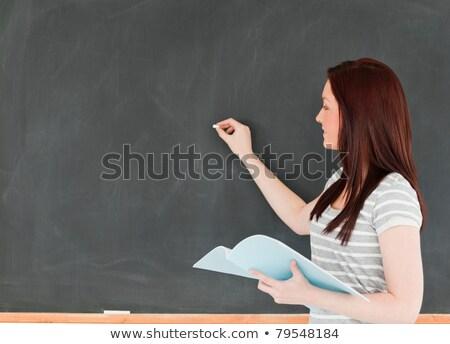 ストックフォト: 若い女性 · 黒板 · ノート · 教室 · 学校