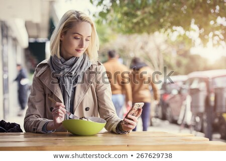 Blonde woman texting with her smartphone Stock photo © wavebreak_media