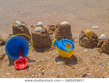 Sandcastle with shovel Stock photo © elxeneize