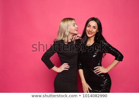 portret · mooie · vrouw · weinig · zwarte · jurk · glimlachend · jonge · vrouw - stockfoto © stepstock
