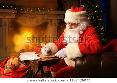 Portrait of Santa Claus answering Christmas letters Stock photo © HASLOO