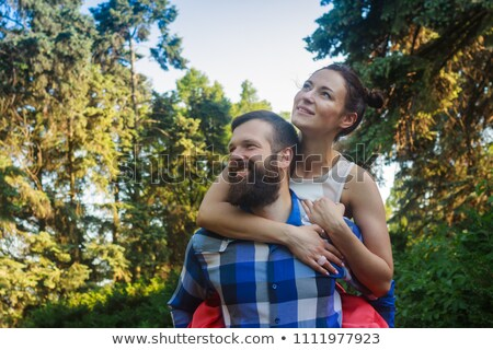 two young lovers holding each other piggyback stock photo © get4net