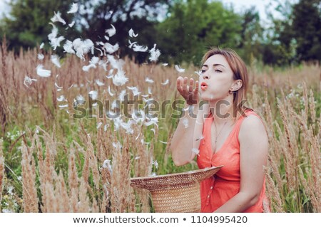 young woman blowing feather stock photo © maros_b