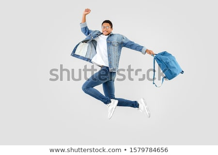 Сток-фото: Portrait Of Teenage Boy Jumping In The Air