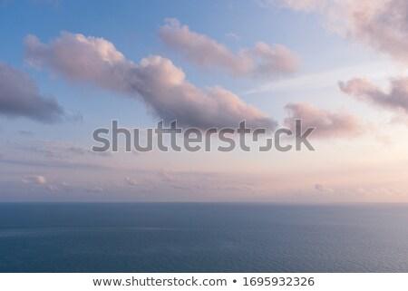 Gouden zonsondergang wolken oceaan strand hemel Stockfoto © Frankljr