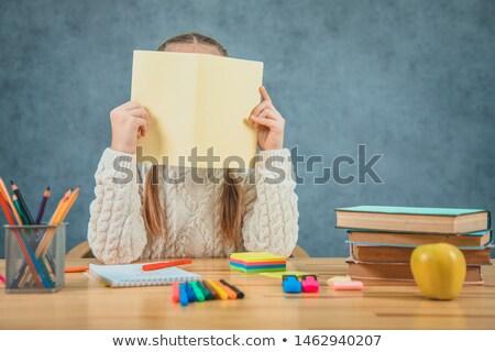 Schoolgirl holding a blank sign hiding her face Stock photo © stryjek