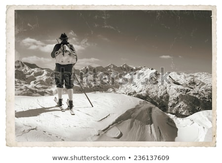 Sepia Vintage skier with wooden skis Stock photo © smuki